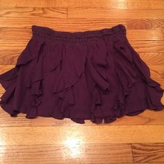 ⚡️1 hour flash sale⚡️Free People ruffled skirt Plum colored ruffled skirt with a crocheted elastic banded waist. Shell is 65% viscose/35%cotton. Liner is 100%cotton. Very cute! Free People Skirts Mini