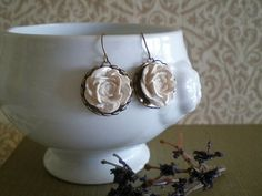 Handmade roses in a lovely cream color affixed to antique bronze hardware. Would be beautiful for a wedding. Earrings measure 20 mm in diameter. Very Sweet and Very Elegant.