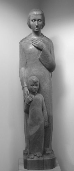 This figure, entitled Take This Child and Make Him Grow, in Elm Grove, Wis., symbolizes the SSND educational mission.