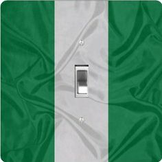 "Rikki KnightTM Nigeria Flag - Single Toggle Light Switch Cover by Rikki Knight. $13.99. The Nigeria Flag single toggle light switch cover is made of commercial vibrant quality masonite Hardboard that is cut into 5"" Square with 1'8"" thick material. The Beautiful Art Photo Reproduction is printed directly into the switch plate and not decoupaged which make these Light Switch Plates suitable for use in any room in the office, home, etc. etc.. These Light Switch Plates can also be..."