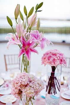 pink centerpieces, would add another color, but love the lilies and the variation in heights