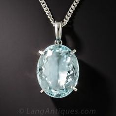 Elegant simplicity meets pretty pastel blue in this simply stunning necklace sparkling solo with a 10.96 carat oval faceted aquamarine set in a minimalist, yet sturdily crafted, platinum pendant. Lovely. Just shy of 1 inch including the loop, the stone alone measures 11/16 by 1/2 inch with a 16 inch platinum chain.