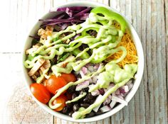 Leftover Chicken Burrito Bowls With Cooked Chicken Breasts, Chopped Cilantro, Lime, Tomatoes, Avocado, Fat Free Yogurt, Chicken, Cooked Rice, Black Beans, Red Cabbage, Anaheim Chile, Cherry Tomatoes, Red Onion, Shredded Cheese, Sauce