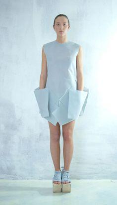 Clean lines, crisp fabric, crazy geometric pockets.