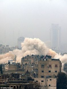 Smoke rises from around the Citadel of Aleppo after a battle between Damascus Front forces attack and regime forces