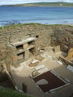 This interior belongs to the Stone Age era. The overall structure, bed, fireplace and storage units are all made from stone. Orkney Islands off N coast of the UK