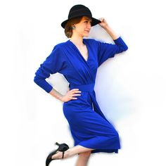 Va-va-voom vampish vintage! This 1950s femme fatale fedora captures the beguiling allure of a sultry sleuth in classic film noir cinema. The millinery fashion hat and the retro 1970s Nancy Drew blue designer dress are both available in LaOohLaLa Boutique!