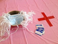Pink tables w/red crosses plus face masks for party? #krystal skinner