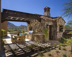 """""""Castle"""" Outdoor Kitchen / Dining with a tiny house or pool room attached. So, perfect!"""