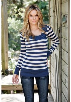 Striped asymmetrical sweater. Lightweight striped sweater features an asymmetrical neckline with faux button detail. Solid neckline and cuffs. Imported cotton rayon/spandex. Sizes S, M, L. Black/grey (BK), denim/oatmeal (NV). 5420  $16.90.