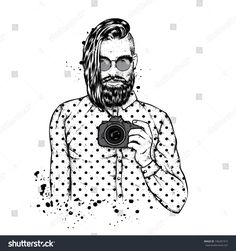 A stylish guy with a fashionable hair and beard. A man with glasses and a camera. Fashion & Style. Hipster. Barbershop.