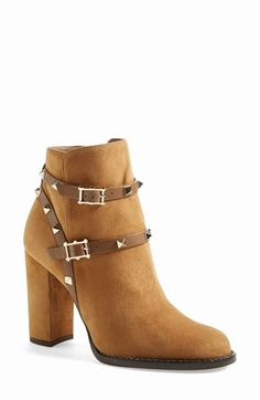 Free shipping and returns on Valentino 'Rockstud' Bootie (Women) at Nordstrom.com. Harness-style straps trimmed in signature pyramid studs toughen up a supple suede ankle boot that's rock-chic, yet refined.