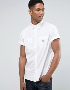Get this Denim & Supply By Ralph Lauren's denim shirt now! Click for more details. Worldwide shipping. Denim & Supply Ralph Lauren Shirt Short Sleeve Worker 2 Pocket in White - White: Shirt by Denim Supply by Ralph Lauren, Woven fabric, Point collar, Button placket, Chest pockets, Logo detail, Regular fit - true to size, Machine wash, 100% Cotton, Our model wears a size Medium and is 185.5cm/6'1 tall. With the latest addition to the Ralph Lauren family, Denim & Supply by Ralph Lauren brings…