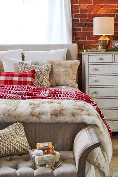Even a spare bedroom can get a holiday makeover without a major investment. Simple seasonal touches like red plaid, a nordic throw or sprigs of evergreen create a festive feel. Add a small gift like scented soap or room spray and guests may stay a little longer! Christmas Bedroom, Farmhouse Christmas Decor, Christmas Home, Apartment Christmas, White Christmas, Girls Bedroom, Bedroom Decor, Bedroom Ideas, Bedroom Inspiration