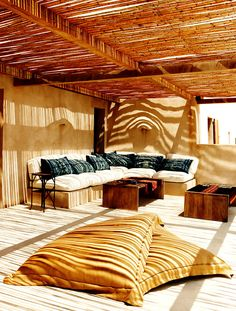 formentera-holiday-villa- love the bamboo terrace roof and the shadows it creates but I don't understand the spouts on the walls, LOL …shared by Vivikene