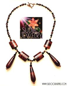 Be the life of the party with his tigers-eye drop necklace. Garnets, crystals and copper finish the look! $65.00