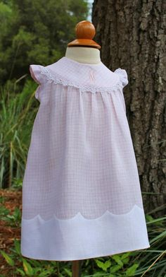 from Farmhouse Fabrics, Pattern is Maime from Children's Corner. White linen was used for Madeira hem. Dress is linen also. Tatting used on yoke edge and monogram.