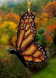Handmade beaded monarch butterfly pendant with golden colour chain