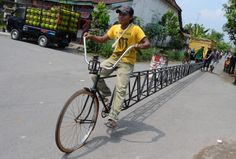 A #bicycle measuring 44ft has been built in #Indonesia - out of rusting iron pipe. Seating just one person, the elongated bike was hand crafted out of 84 feet of piping in Blawe village, Kediri, East Java, Indonesia, pict. Arief Priyono / Barcroft Media
