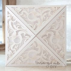 Extravaganza Laser Cut Range in White  Laser cut wedding invitations perfect for your luxury wedding. DIY laser cuts are easy and elegant with options to insert your own printer inserts.