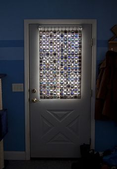 Kodachrome may be out of stock, but for some it will never go out of style. This set dating back decades was appropriated, drilled and stitched back together to form a flexible but light-filtering window shade for an entry doorway.