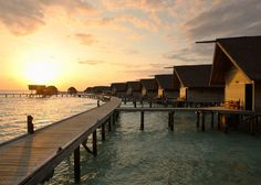 Spectacular sunset view from Loft Villas Walkway in Cocoa Island, Maldives. For offers email us at enquire@extraordinaryescapes.com.au