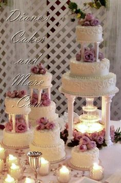 Something like what Jimmy would pick. (He wants a fountain on/in the cake somewhere). Big Wedding Cakes, Wedding Cake Fresh Flowers, Wedding Cakes With Cupcakes, Elegant Wedding Cakes, Wedding Cake Designs, Pretty Cakes, Beautiful Cakes, Fountain Wedding Cakes, Quinceanera Cakes