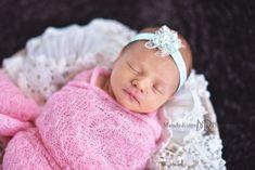 Newborn girl portraits // pink wrap, aqua, teal, mint headband, black rug, round basket, vintage lace stuffer // client's home - Geneva, IL // by Mandy Ringe Photography