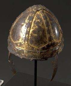 Ornate Byzantine Spangenhelm from a grave in Gammertingen Germany, 6th century, six iron plates, which are held together by six clips of copper and an iron, covered with sheet copper circlet. All parts are richly decorated and were originally gilded, a Byzantine officers helmet of the type manufactured in Balkan and Italian workshops for the needs of the Eastern Roman army.