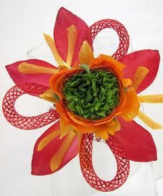 """Sprout Flowers always comes up with fab corsages for prom!    Crazy composite flower made out of three different kinds of flowers.  Oooh - don't forget the cool mesh tubing """"petals""""! - By Sprout Flowers"""