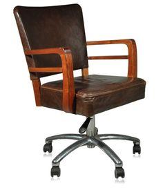 Cadeira giratória em couro natural estonado e braços em caviúna. Fabricação Giroflex, década de 50.    www.desmobilia.com.br