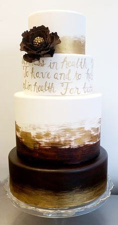 Gold and chocolate brown watercolor cake with hand painted calligraphy vows and gum paste flower (4-tier, fondant)