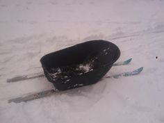 Homemade Sled..wheelbarrow on skis. Maybe this one will last for more than a day or two....we really put our sleds through it.