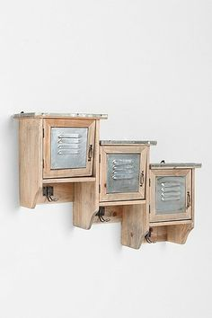 I can't decide if I like this more for a catchall by the back door... or for the twins' baseball themed room. Either way, I'm loving this reclaimed wood locker shelf from urban outfitters.
