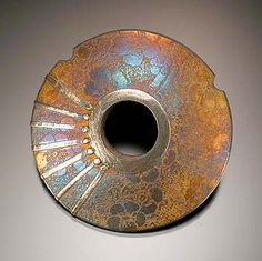 Kelly Russell creates incredibly detailed antique looking beads, and pendants out of metal clay.
