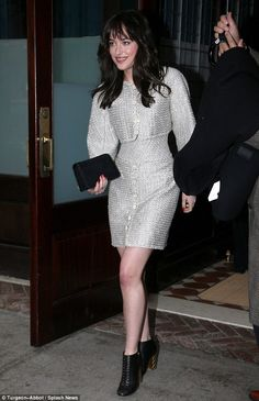 Elegant: Dakota Johnson stepped out in a white and silver two-piece in New York on Tuesday