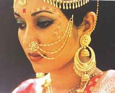 Indian bride jewellery, huge gold hooped chandelier earrings and headdress, pretty gopi dots, nose ring with beautiful chain