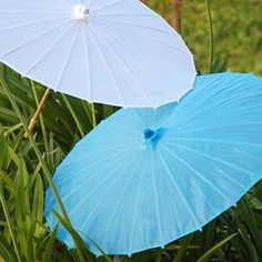 These cool color nylon parasols will be such a welcome treat for guests at your outdoor wedding, bridal shower or garden party. Available in your choice of light, spring colors, each parasol is made of durable nylon with a wooden handle. Outdoor Wedding Decorations, Bridal Shower Decorations, Outdoor Weddings, Reception Decorations, Unique Wedding Favors, Unique Weddings, Vintage Beach Weddings, Wedding Pics, Wedding Ideas