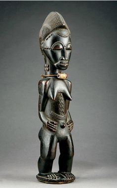 Africa | Statue from the Baule people of the Ivory Coast | Wood, fiber, bone