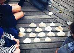 Beach memory game. Get the kids to find pairs of tiny objects on the beach and hide them under large shells.