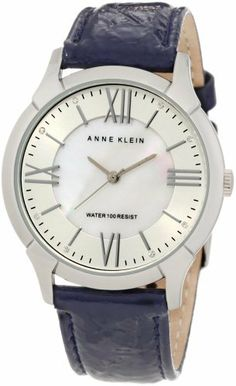 Anne Klein Women's 10/9925MPNV Leather Silver-Tone Navy Blue Patent Leather Strap Watch Anne Klein. $65.00. White mother-of-pearl dial with silver-tone applied roman numeral iii, vi, ix  xii markers and stick markers at all other hours. Silver-tone hour, minute and second hands. Water resistant up to 100 ft.. Large 35 mm round case finished in polished silver-tone. Navy blue, crinkled patent leather strap, padded and stitched with a stainless steel buckle closure