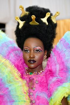 Arguably one the most fun and head-turning looks of the night, Lupita Nyong'o stunned in her rainbow ensemble at the 2019 Met Gala. From gravity-defying hair to a multi-metallic make-up look, here's how her team created such a memorable beauty moment Sienna Miller, Rosie Huntington Whiteley, Penelope Cruz, Celine Dion, Will Turner, Hailey Baldwin, Lily Collins, Emma Stone, Priscilla Presley