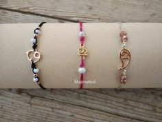 Items similar to New Year's lucky charm bracelet. on Etsy Lucky Charm Bracelet, Macrame Cord, Stocking Fillers, Adjustable Bracelet, Pink And Gold, Glass Beads, Stockings, Charmed, Wristlets