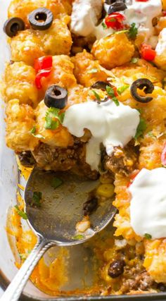 This Tater Taco Casserole is a Mexican mixture of taco meat, beans, corn, and cheese topped with tater tots and enchilada sauce. The family will love it. This Tater Taco Casserole is a dish that the Mexican Dishes, Mexican Food Recipes, Beef Recipes, Dinner Recipes, Cooking Recipes, Ethnic Recipes, Recipies, Dinner Ideas, Mexican Snacks