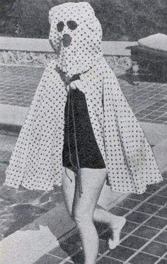 """, the """"Freckleproof Cape"""" was worn by 1930s bathers to avoid sunburns and freckles. The cape also came with built-in sunglasses."""