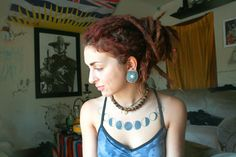 Moon Phase tattoo, sun dried plug and redhead dreads :)