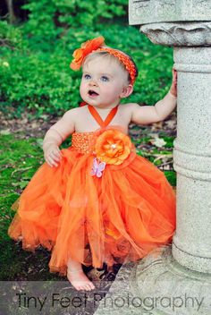 $18 plus 3 shipping, on sale right now from Teeny Tiny Tutus on FB.  I love it in orange, but they also have it in green (Christmas dress and also to use later in spring for pictures???)  I want this so much!