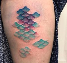 Colorful mermaid scale tattoo