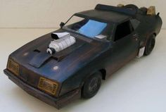 Mad Max - 1973`s Ford Falcon XB GT Coupe Paper Model - by Paperinside - Assembled by Loenf - == -   This very well done paper model with great textures of the 1973`s Ford Falcon XB GT Coupe, from Mad Max movie, was created by Brazilian designer Claudio Dias. The model that you see in the photos of this post was assembled by German modeler Loenf and originally posted at Paper Modelers forum.