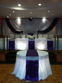Wedding Reception: Head table .. bling ribbon table .. drape .. fabric panel strips ..